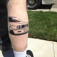 inchiostro nero macchina tatuaggio sulla gamba