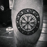 Black ink circle shaped leg tattoo of circle shaped symbol