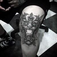 Black ink cool looking knee tattoo of demon head