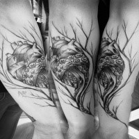 Black ink cool sketch style forearm tattoo of human heart with tree