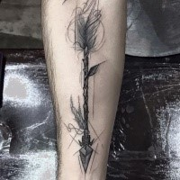 Black ink creative looking forearm tattoo of ancient arrow
