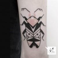 Black ink detailed arm tattoo of big bug