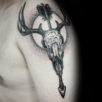 Black ink dot style shoulder tattoo of animal skull with arrow