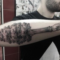 Black ink engraving style arm tattoo of big tree combined with arm