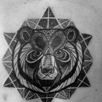 Black ink geometric bear head tattoo