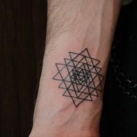 Black ink geometric wrist tattoo