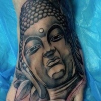 Black ink Hinduism style medium sized foot tattoo of Buddha statue