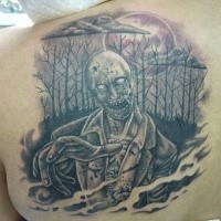 Black ink horror style big shoulder tattoo of dark zombie in woods