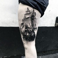 Black ink incredible looking thigh tattoo of sailing ship