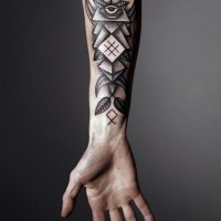 Black ink innovative geometric forearm tattoo