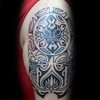 Black ink large shoulder tattoo of Polynesian style ornaments