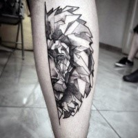 Black ink leg tattoo of lion head half