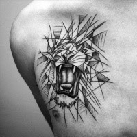 Black ink linework style chest tattoo of roaring lion