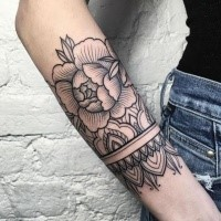 Black ink linework style forearm tattoo of rose