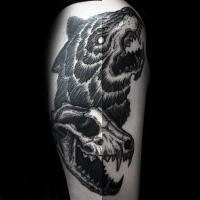 Black ink linework style tattoo of animal skull with bears head