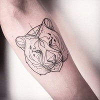 Black ink medium size forearm tattoo of tiger head