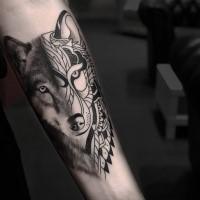 Black ink nice looking forearm tattoo of half realistic half ornamental wolf portrait