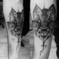 Black ink old looking forearm tattoo of wolf by Inez Janiak with lettering