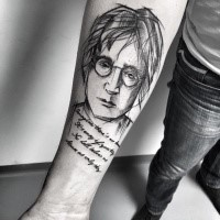 Black ink painted by Inez Janiak memorial tattoo of Lennon portrait with lettering