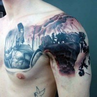 Black ink shoulder and chest tattoo of 300 Spartans movie scene
