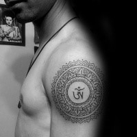 Black ink shoulder tattoo of Hinduism symbol