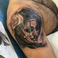Black ink shoulder tattoo of Mexican style woman portrait with rose