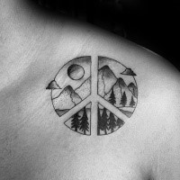 Black ink shoulder tattoo of pacific symbol stylized with mountains and forest