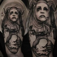 Black ink style creepy looking shoulder tattoo of demonic woman with little baby