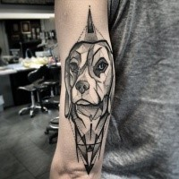 Black ink tattoo painted by Michele Zingales in geometrical style dog on arm