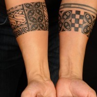Black ink tribal forearm tattoo for men