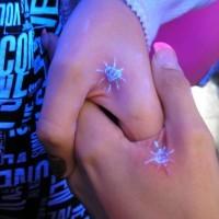 Black light diamonds tattoo for couple