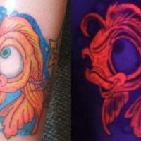 Black light fish tattoo double image