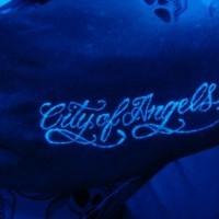Black light script tattoo on the palm