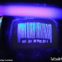 Black light tattoo bar code on head