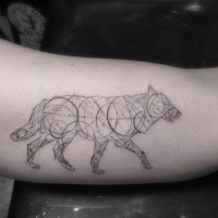 Black lines a wolf of geometric shapes tattoo on arm