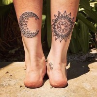 Black lines patchwork sun and moon tattoo on legs