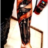 Black mechanism tattoo on arm