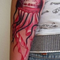 Black red jellyfish forearm tattoo
