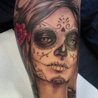 Black santa muerte girl with a red rose in hair tattoo