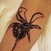 Black spider tattoo on arm