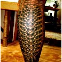 Black spine tattoo on leg