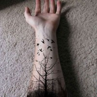 Black tree forearm tattoo design for men
