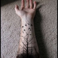 Black tree tattoo design for men on arm