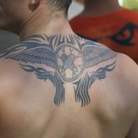 Black tribal wings tattoo on upper back