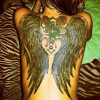 Black wings with red roses and cross tattoo on back