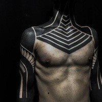 Blackwork style amazing looking shoulder and chest tattoo of various ornaments