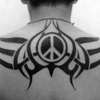 Blackwork style big back tattoo stylized with pacific symbol