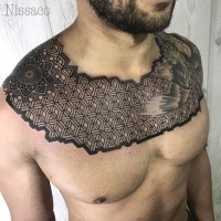 Blackwork style creative enormous collarbone tattoo of geometrical ornament with bird