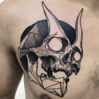Blackwork style designed by Michele Zingales chest tattoo of demonic skull