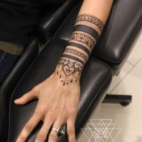 Blackwork style impressive painted arm tattoo of nice ornaments